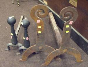 Pair of Wrought Sheet Iron Scroll Andirons and a Pair of Cast Iron Andirons