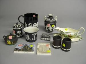 Seven Wedgwood Basalt and Black Jasper Items Two Calendar Tiles and a Queens Ware Hunt Scene Decorated Sauceboat