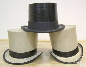 Three cast iron top hat spittoons late 19th c