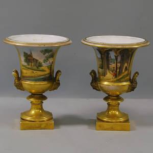 Pair of Paris Porcelain Parcelgilt Urns