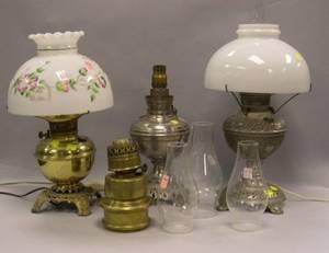 Two Nickel Plated Kerosene Lamps Two Brass Kerosene Lamps and a Cast Iron Wall Mount Kerosene Lamp
