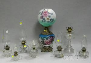 Seven Colorless Pressed Glass Kerosene Lamps and a Rosedecorated Glass and Brass Kerosene Gonewiththewind Table Lamp