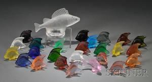 Twentyfive Lalique Fish Seals and a Lalique Fish Sculpture