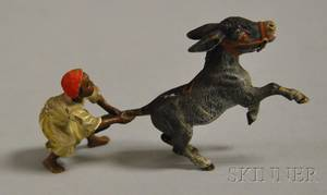 Austrian Miniature Coldpainted Bronze Figure of an Arab Boy Pulling the Tail of a Rearing Donkey