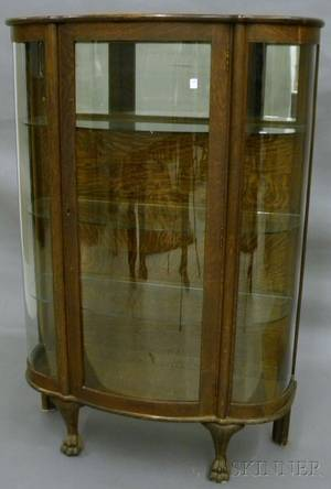 Early 20th Century Carved Oak and Bent Glass Panel China Cabinet