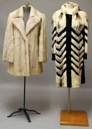 Two Fur Coats Including a Black and White Art Decostyle Fur and Lambs Wool Coat