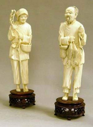 Pair of Chinese Carved Ivory Figures of a Peasant Man and Woman