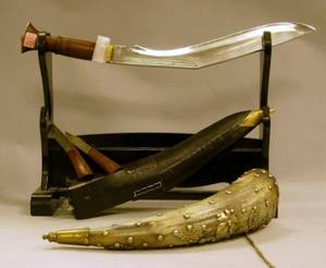 Tacked Brass Decorated Powder Horn a Kukri Knife and a Wooden Sword Stand