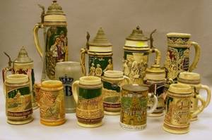 Fourteen Assorted German Stoneware Steins and Two Porcelain Steins