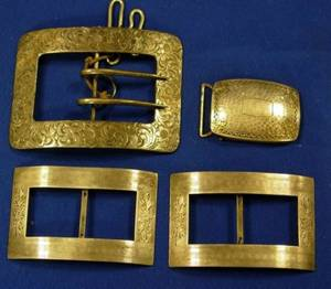 Four Sterling Silver Buckles and a Group of Goldfilled Watch Chains
