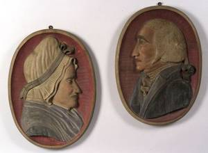 Pair of Carved and Painted Wooden George and Martha Washington Plaques