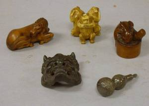 Two Japanese Carved Wood Netsukes and a Carved Ivory Netsuke a Small Silver Gourdform Netsuke and a Small Cast Bronze Mask