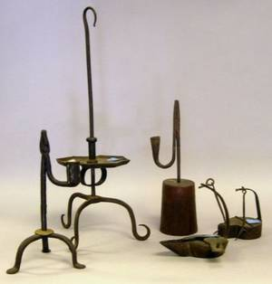 Two Iron Betty Lamps Two Rush Holders and an Iron Candlestand