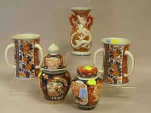 Two Imari Palette Covered Jars a Vase and a Pair of ThreeHandled Cups