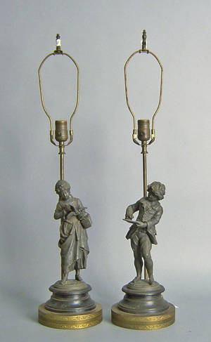 Pair of figural spelter table lamps of a man and woman