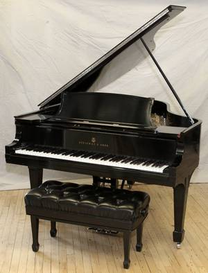 STEINWAY EBONIZED WOOD GRAND PIANO W BENCH