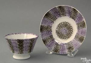 Purple and black spatter miniature cup and saucer 19th c