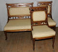 121417 LATE VICTORIAN CARVED WALNUT PARLOR SETTEE AND