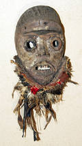 113273 CARVED WOOD MASK WITH RAFFIA FEATHERS BEADS