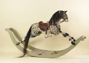 Large carved and painted dappled rocking horse late 19th c