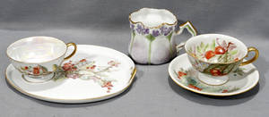 011518 GERMAN PORCELAIN TEA CUPS SAUCERS AND PLATES