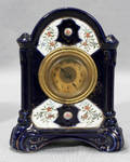 121549 MOLDED DEMI PORCELAIN CLOCK EARLY 20TH CENTURY