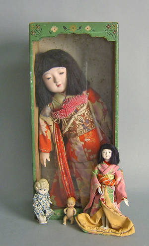 Japanese geisha doll in painted wooden box