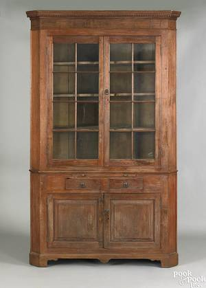 Western Pennsylvania Federal walnut onepiece corner cupboard early 19th c