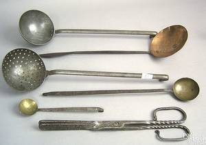 Group of wrought iron copper and brass table implements early 19th c