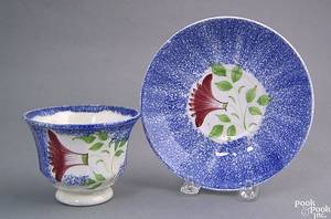 Blue spatter paneled cup and saucer