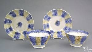 Pair of blue and yellow rainbow spatter cups and saucers