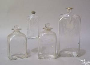 Four Steigel type clear blown glass bottles late 18th c