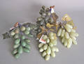 Four stone bunches of carved grapes and grape leaves