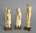 Three carved ivory figures