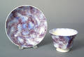 Blue and purple rainbow spatter cup and saucer 19th c