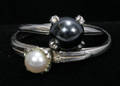030384 PEARL AND STERLING SILVER RINGS 2 PCS