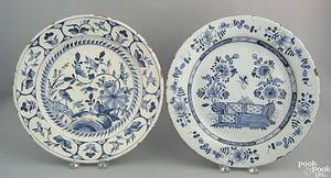 Two English blue and white delft chargers 18th c