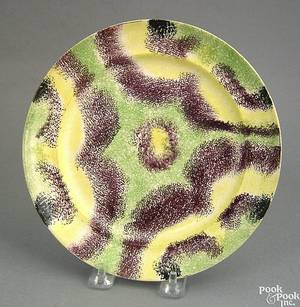 Vibrant green yellow purple and black rainbow spatter drape plate