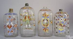 Four Steigel type blown polychromed enamel decorated bottles late 18th c