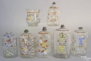 Six Steigel type blown clear glass bottles late 18th c
