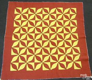 Red and yellow calico pieced quilt