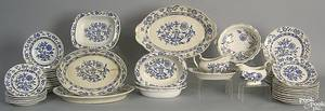 Fifty pcs of blue and white china with gold trim to include 2 gravy boats