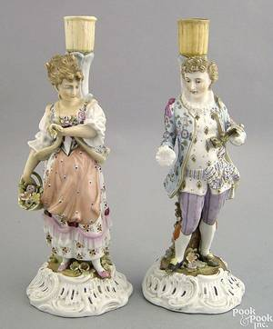 Pair of porcelain candlesticks of a man and woman 19th c