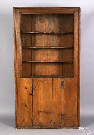 New England pine one piece corner cupboard early 19th c