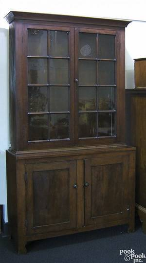 Pennsylvania two piece cherry wall cupboard ca 1820