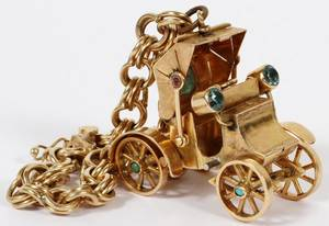 18KT GOLD AUTOMOBILE CHARM W 14KT GOLD BRACELET