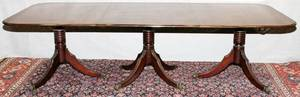 MAHOGANY TRIPLEPEDESTAL DINING TABLE