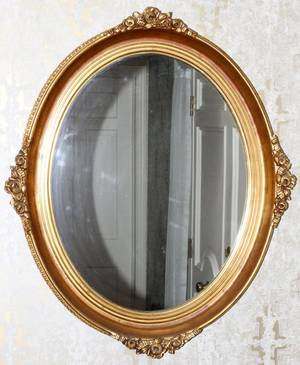 CARVED GILT WOOD OVAL WALL MIRROR 20TH C