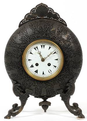 LMARTI ET CIE PATINATEDPIERCED BRASS MANTEL CLOCK