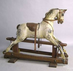 Swallow Toys carved and painted rocking horse early 20th c